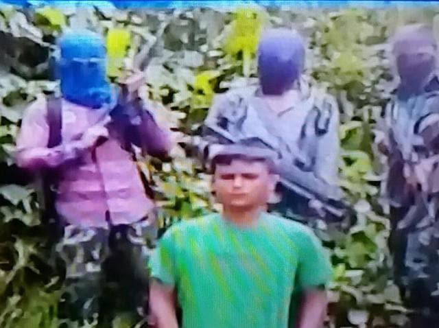 TV grab of the video released by ULFA-I shows Kuldeep Moran surrounded by five masked gun-totting militants.