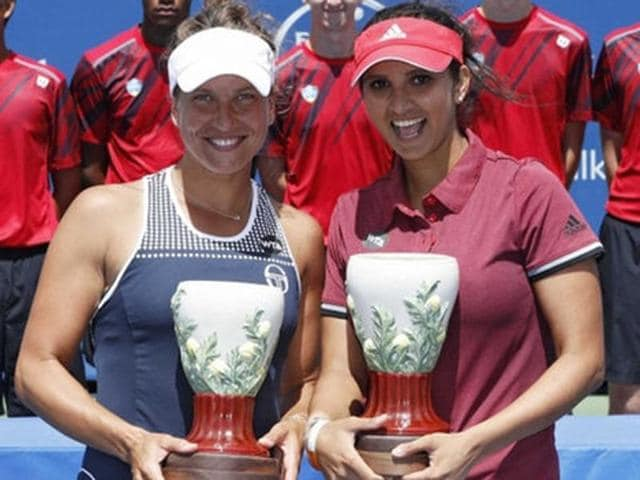 Sania Mirza and Barbora Strycova with the Cincinnati Master trophy.