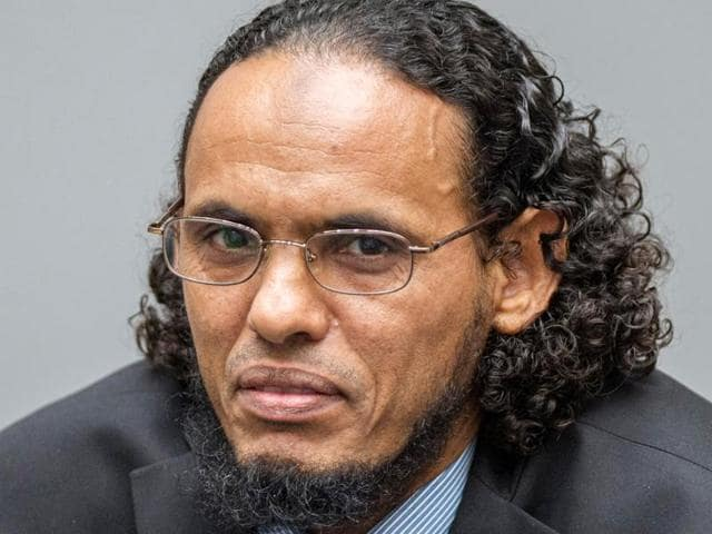 Ahmad al-Faqi al-Mahdi appears at the International Criminal Court in The Hague, Netherlands at the start of his trial on charges of involvement in the destruction of historic mausoleums in Timbuktu during Mali's 2012 conflict.