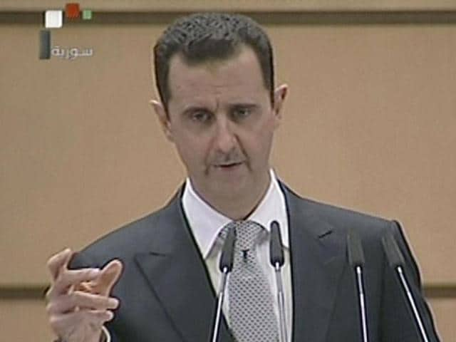 This videograb from Syrian state television shows Syrian President Bashar al-Assad delivering a speech in Damascus.