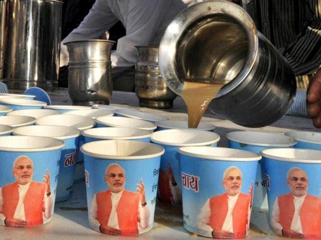 A man serves tea during Narendra Modi's 'Chai pe Charcha' sessions in New Delhi.