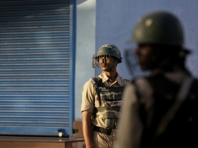 Paramilitary soldiers guard during curfew in Srinagar.