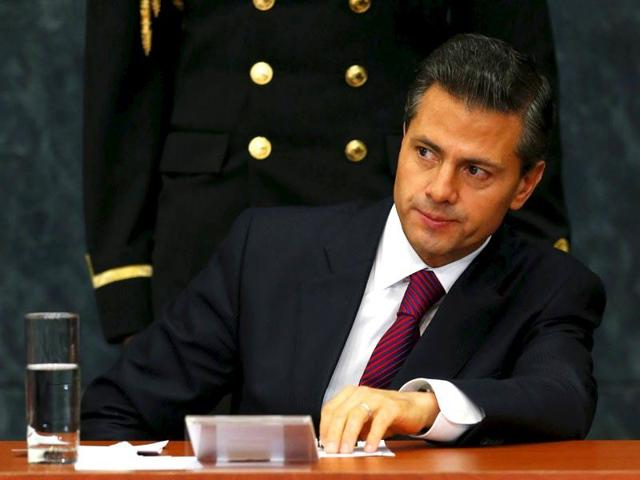 Mexico's President Enrique Pena Nieto gestures during an investment announcement from brewer Grupo Modelo at Los Pinos Presidential house in Mexico City.