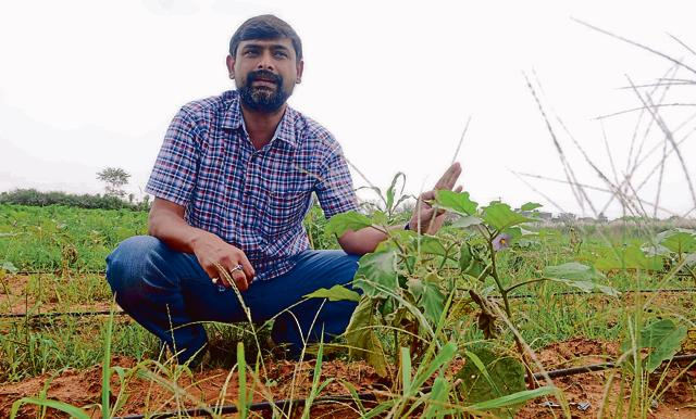 Rajiv Kamal Bittu at his farm at Ormanjhi village in Ranchi.
