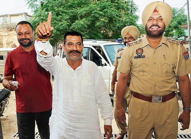 Punjab Gau Raksha Dal chief Satish Kumar (in white) coming out of a Rajpura court in Patiala on Sunday.