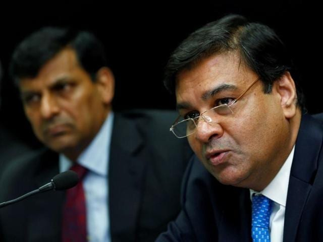 Reserve Bank of India (RBI) deputy governor Urjit Patel attends a news conference with Raghuram Rajan (left) in Mumbai.