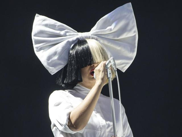 Sia took to the stage in her iconic black and white wig and oversized white bow.
