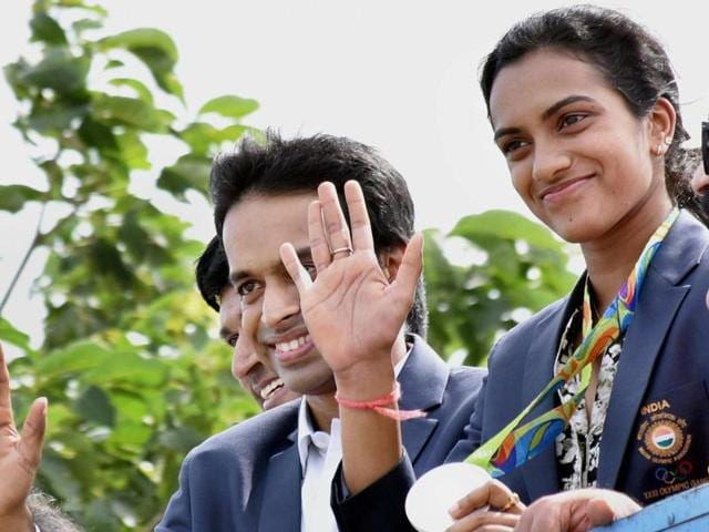 Olympic silver medallist PV Sindhu with her coach P Gopichand in Hyderabad on Monday.