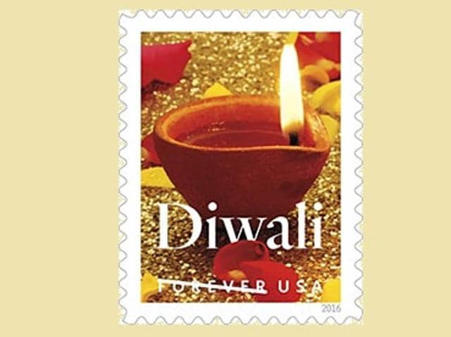 The stamp design, unveiled by the US Postal Service (USPS), is a photograph featuring a traditional diya (oil lamp) lit in a sparkling gold background.