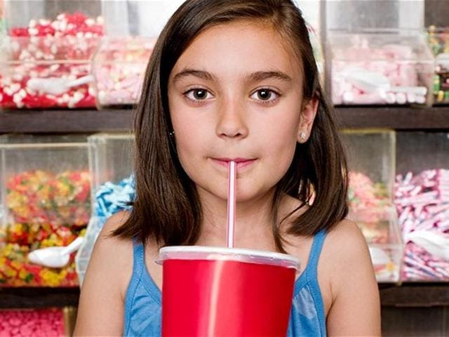 Children between the age of two-to-18 months consuming more than six teaspoons of added sugars a day -- equivalent to about 100 calories or 25 grams of added sugars -- may be at an increased risk of obesity and elevated blood pressure that are key factors for developing heart disease, a study has found.