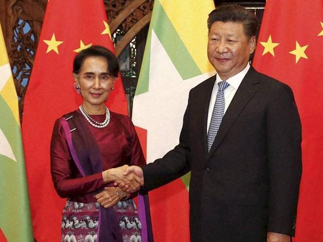 Myanmar State Counselor Aung San Suu Kyi reviews honour guards during a welcoming ceremony at the Great Hall of the People in Beijing on August 18.