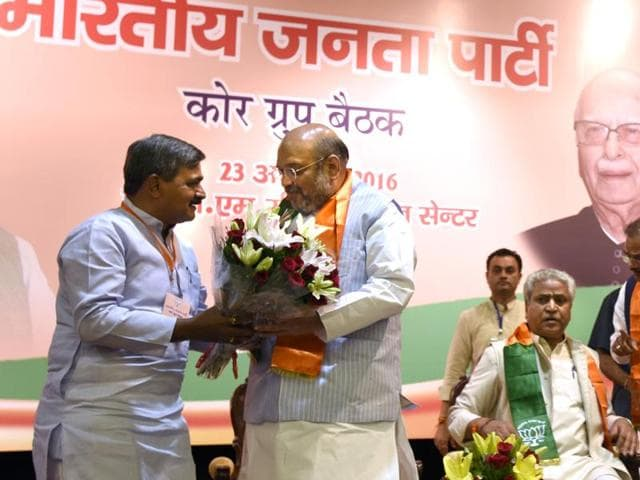 BJP National president Amit Shah being welcomed by Delhi BJP president Satish Upadhayaya as the representative from across the country attend the Meeting of Core Group in New Delhi, India, on Tuesday, August 23, 2016.