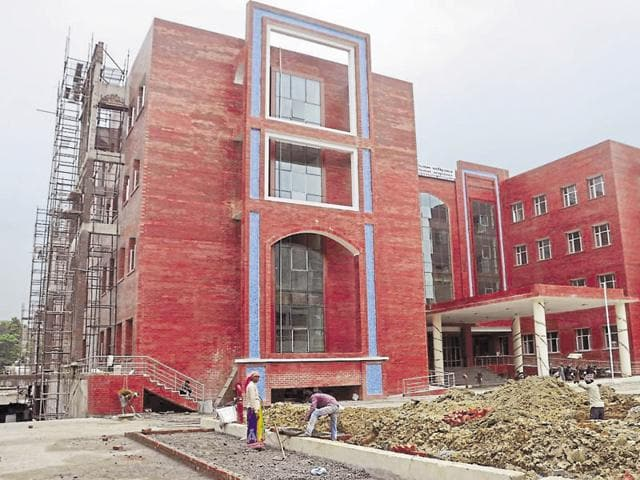 Works underway at the new MC building at Ranjit Avenue in Amritsar on Monday.