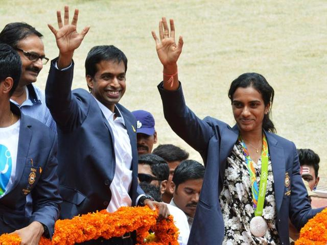 Silver medalist badminton player PV Sindhu (R) and her coach Pullela Gopichand during a felicitation parade after their return from Rio Olympics, upon their arrival in Hyderabad.