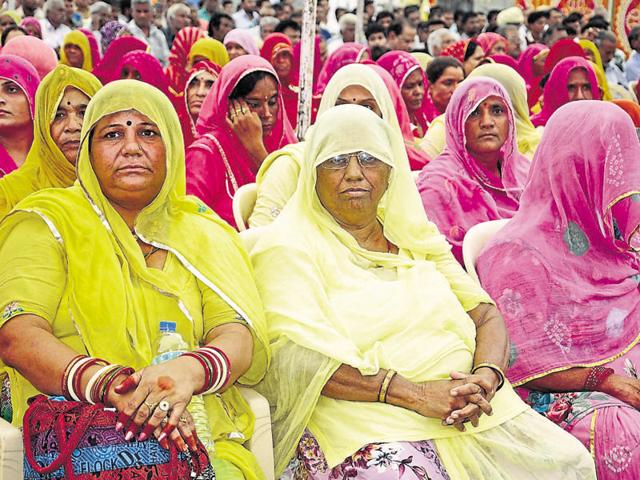 Gangster Anandpal Singh's mother Nirmal Kanwar (centre) defended her son at a protest rally organised by the Ravana Rajput community at Vidyadhar Nagar stadium on Monday. Over 3,000 people had gathered in the state capital to protest against the regular harassment of the gangster's family members by the police in the name of inquiry.