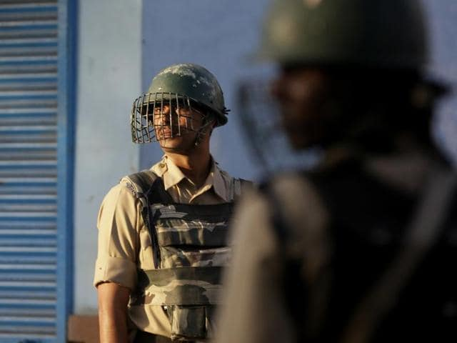 Policemen stand guard during curfew in Srinagar.
