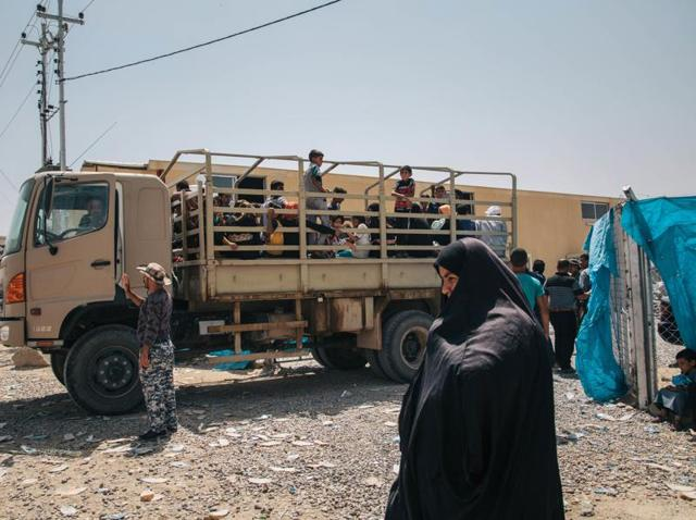 In this August 17, 2016 photo, a truck carrying civilians who recently fled territory formerly controlled by Islamic State militants arrives at at the Dibaga Camp for displaced people in Hajj Ali, northern Iraq.