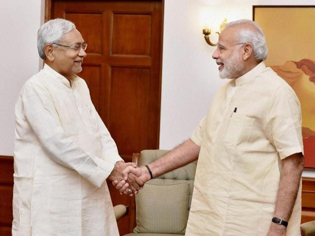 Prime Minister Narendra Modi shakes hands with Bihar chief minister Nitish Kumar during a meeting to discuss flood situation in the state.