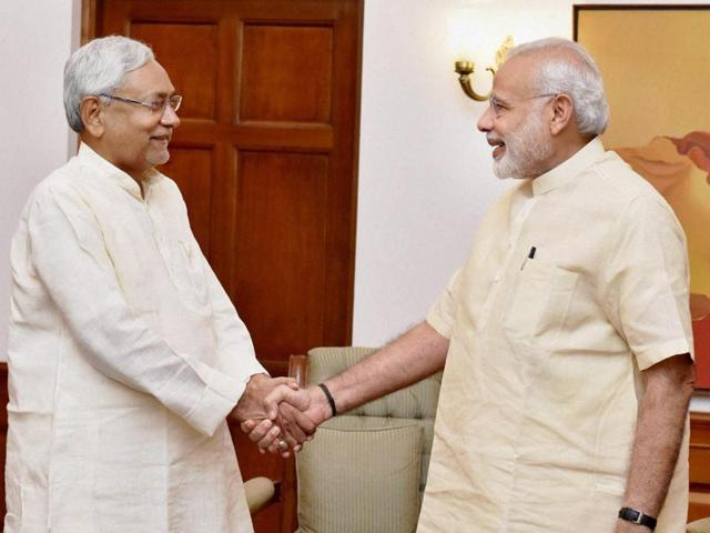Prime Minister Narendra Modi with Bihar chief minister at a meeting to discuss the flood situation in the state.