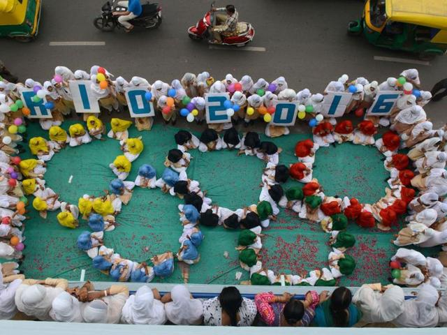 School children form the emblem of the Rio 2016 Summer Olympics in Ahmedabad.
