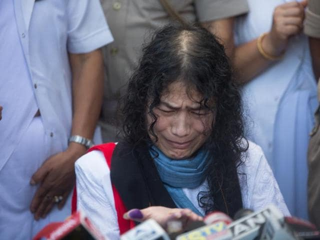 Activist Irom Sharmila licks honey from her hand to break her fast in Imphal on August 9, 2016.
