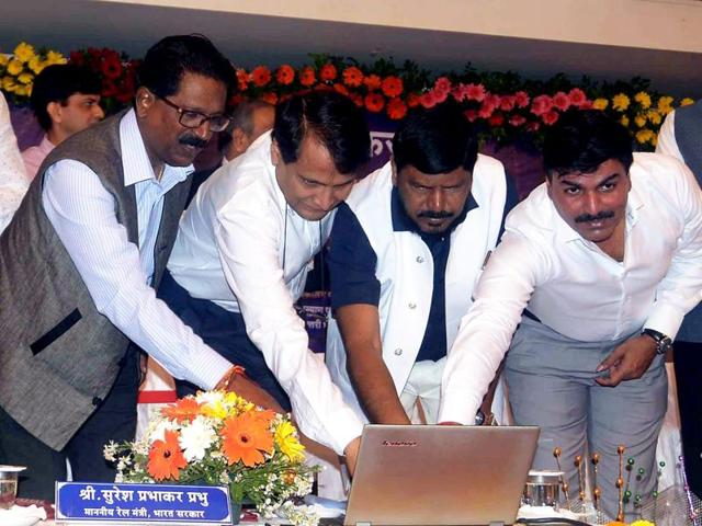 Union railway minister Suresh Prabhu and social justice minister Ramdas Athawale at a programme in Mumbai on Monday.