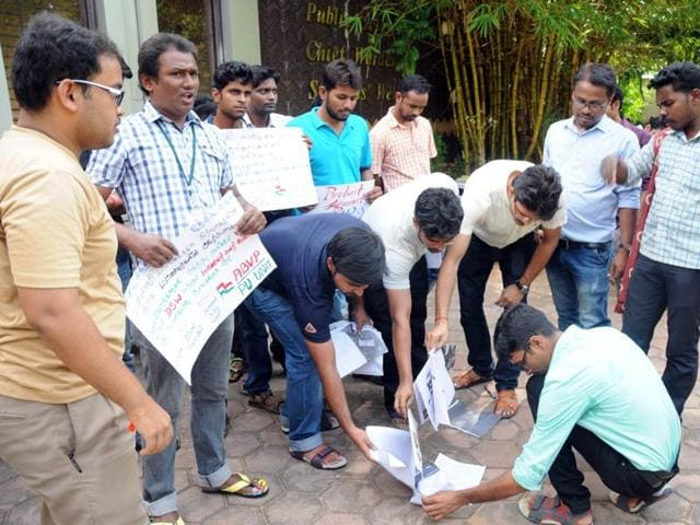 Protesters burning copies of the Widerstand magazine in the Pondicherry University premises.s