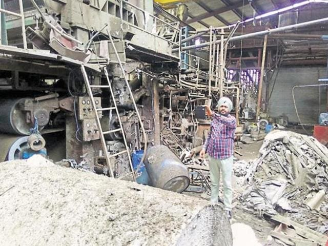 A man explaining the damage inside the paper factory where a blast in a boiler killed three labourers in Malerkotla, Sangrur district, on Monday.