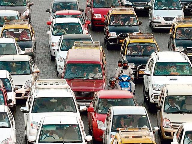 Transport or Commercial category vehicles— ones with yellow number plates — include buses, taxis, trucks and auto rickshaws
