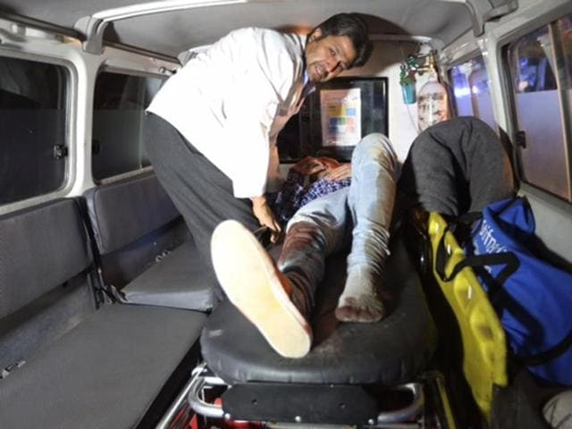 A wounded person is treated in an ambulance after an attack on the campus of the American University in the Afghan capital Kabul.