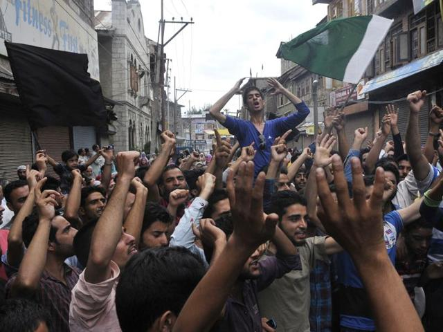 Protesters shout slogans agaist security forces after the killing of a teenager named Irfan Ahmed in Srinagar on August 22.