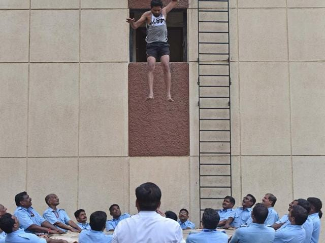 An aspirant lands on a sheet during the recruitment drive by the fire brigade in Borivli on Tuesday.