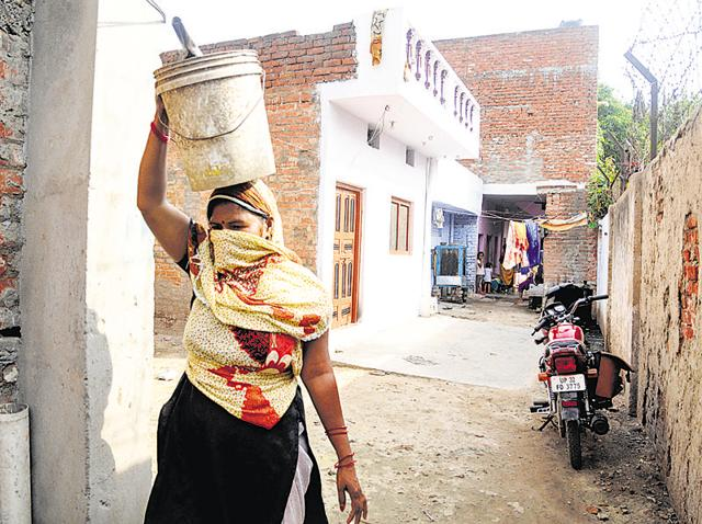 Asha Valmiki, from Valmiki Nagar in Iradat Ganj, Old Lucknow, cleans human excreta by hand. Activists say Uttar Pradesh has more than 100,000 manual scavengers as the implementation of the law has been lax.