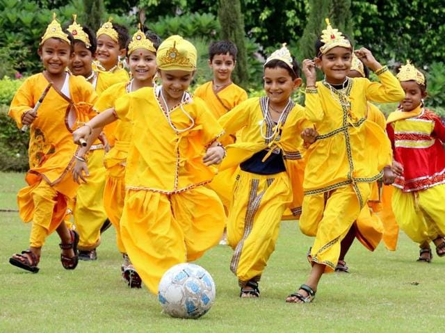 Gods' field: Children dressed as Lord Krishna play football on the eve of Janmashtami  in Patiala on Wednesday. (Bharat Bhushan/HT Photo)