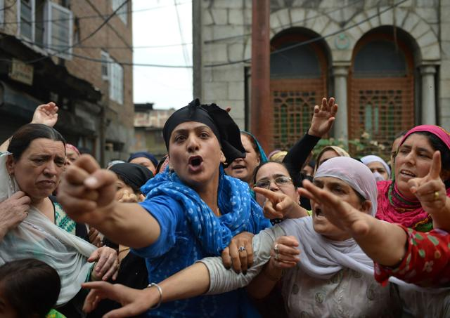Kashmiri protesters shout pro-freedom and anti-Indian slogans during mourning and protests held in Srinagar on August 22,  following the killing of teenager Irfan Ahmed by security forces.