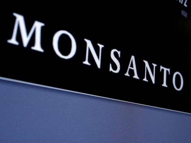 Monsanto is displayed on a screen where the stock is traded on the floor of the New York Stock Exchange.