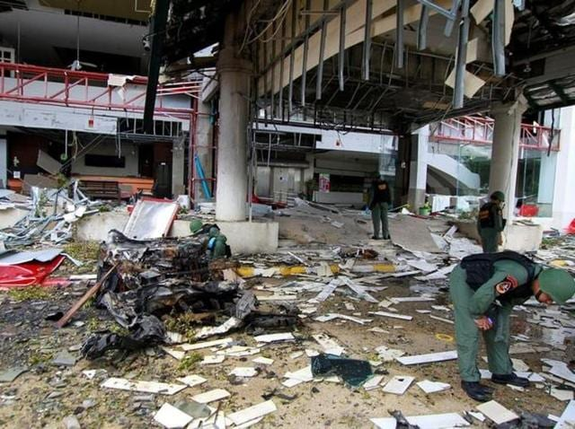 Thai soldiers inspect the scene of a car bomb blast outside a hotel in the southern province of Pattani, Thailand.