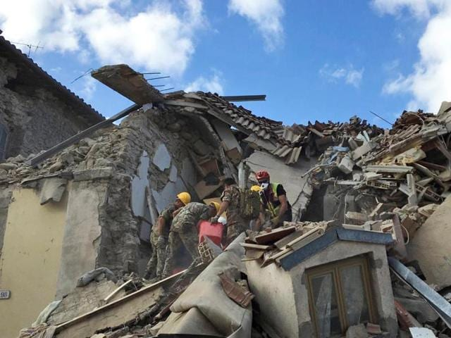 Rescuers work following an earthquake that hit Amatrice, central Italy.