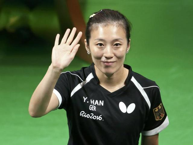 Germany's Han Ying waves to the crowd before the doubles final of the women's table tennis against China in Rio.