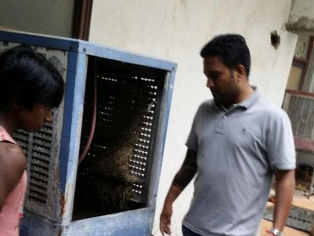 A member of the health department inspecting mosquito larva in a cooler in Jalandhar on Wednesday.