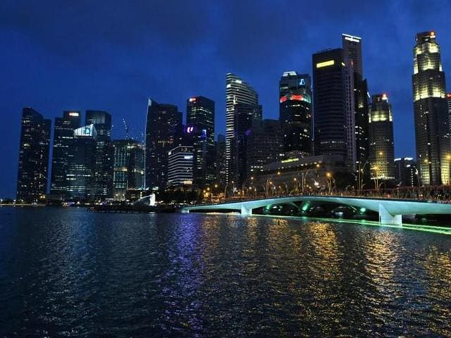 A general view shows the financial business district skyline glittering with lights in Singapore.