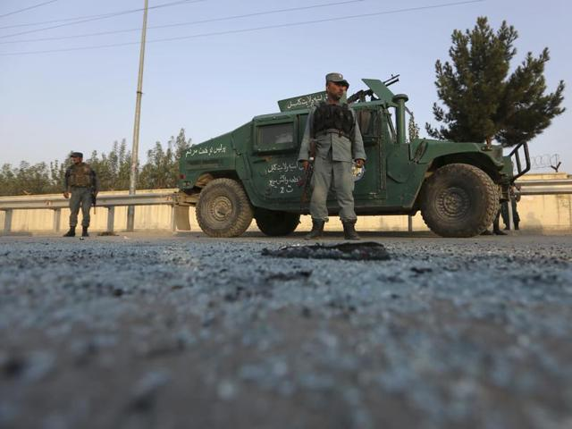 Afghan security forces stand guard after an attack on the American University of Afghanistan in Kabul, Afghanistan.