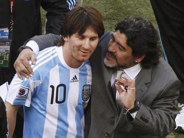Argentina's coach Diego Maradona (R) hugs Lionel Messi after their 2010 World Cup Group B match.
