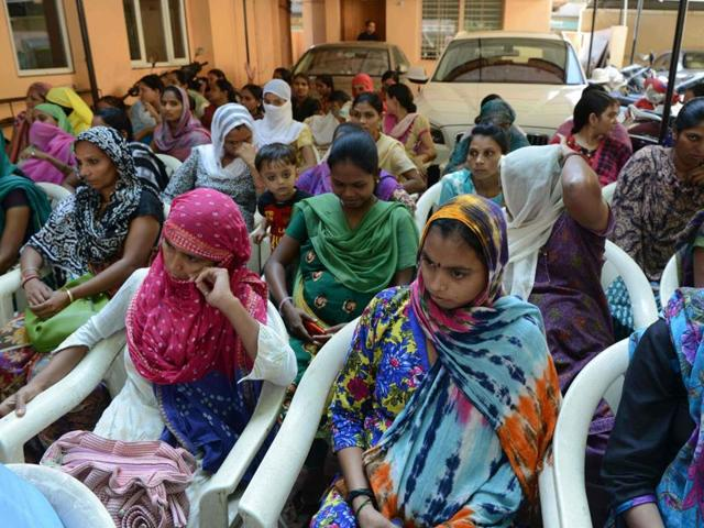 This file photograph taken on October 29, 2015, shows Indian surrogate mothers as they gather during a peaceful protest in the campus of Dr. Nayana Patel's Kaival Hospital in Anand, some 90km from Ahmedabad.