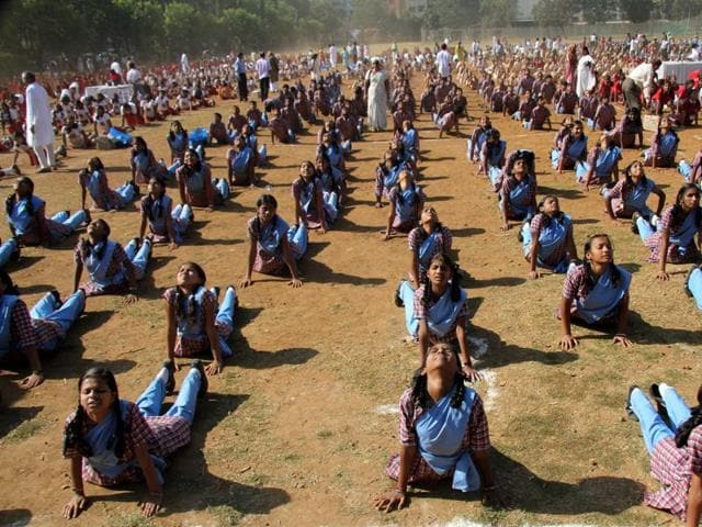 More than 3000 students from 20 schools performed Suryanamaskar, a form of Yoga on the 150 h anniversary of Swami Vivekanand in Mulund Sambhaji ground, Mumbai.