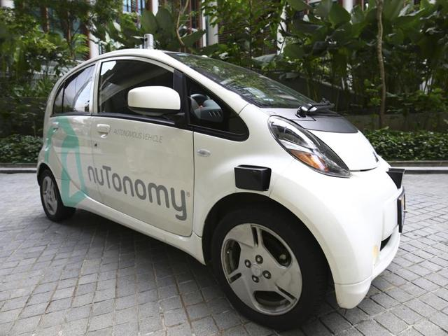 A nuTonomy self-driving taxi drives on the road in its public trial in Singapore on Thursday.