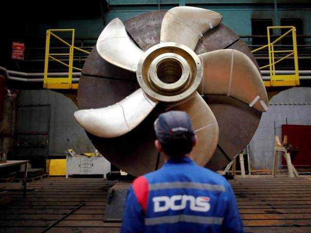 File photo of an employee looking at the propeller of a Scorpene submarine at the industrial site of the naval defence company and shipbuilder DCNS in La Montagne near Nantes, France.(Reuters)