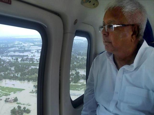 RJD chief Lalu Prasad conducting an aerial survey to flood-hit riverine area in Fatuha and Bakhtiarpur blocks of Patna on Tuesday.
