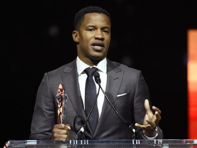In this April 14, 2016 file photo, Nate Parker, director of the upcoming film The Birth of a Nation, accepts the Breakthrough Director of the Year award during the CinemaCon 2016 Big Screen Achievement Awards in Las Vegas. The American Film Institute has canceled plans to screen writer-director Nate Parker's movie  for students this week amid controversies surrounding a 17 year old rape accusation of Parker and his co-writer.