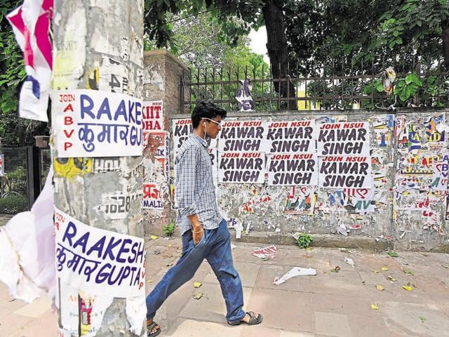Posters of party candidates pasted on DU's walls ahead of the DUSU election in New Delhi on Thursday.